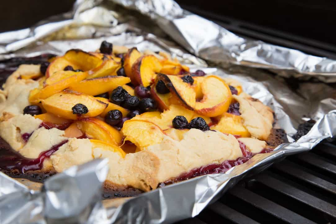 grilled peach and blueberry galette, via www.goodfoodstories.com