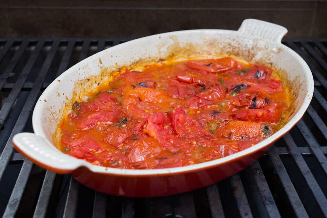 cooking tomato sauce on the grill, via www.goodfoodstories.com