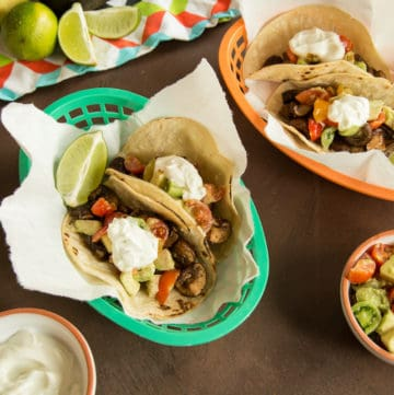 Mushroom tacos with yogurt crema make a hearty vegetarian option for taco night. #taconight #veggietacos