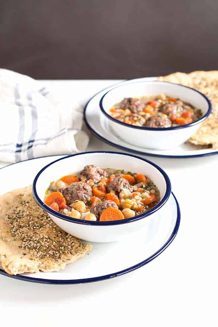 Packed with protein, this meatball, garbanzo bean, and lentil tomato soup is a filling family meal. #familydinner #meatballsoup #mediterranean