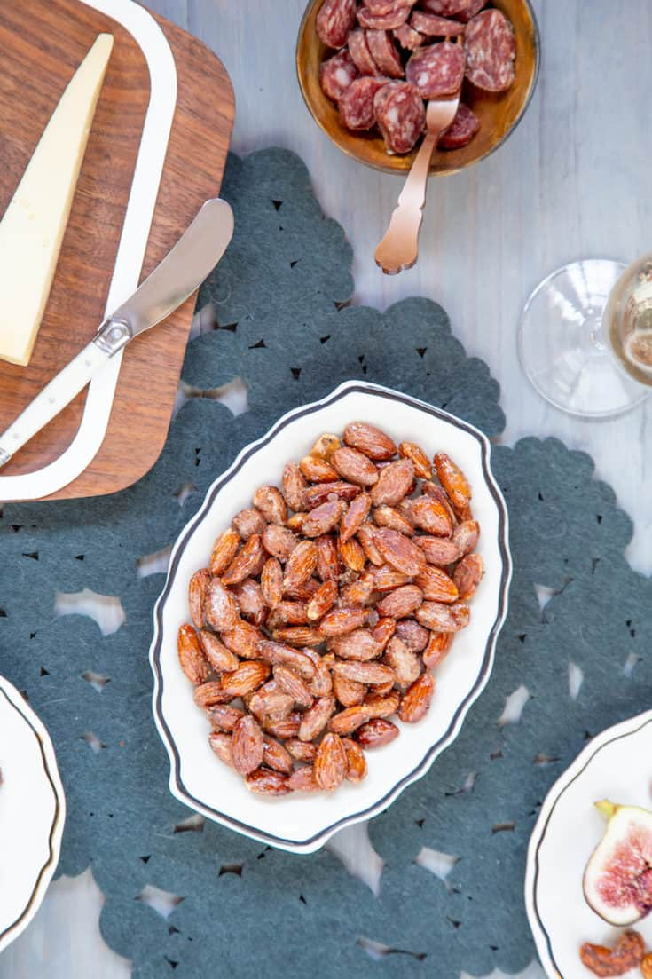 Maple spiced nuts balance a crunchy, sweet maple syrup glaze with a touch of heat from smoky chipotle and black pepper. #maplespicednuts #spicednuts #partysnacks #partyrecipes