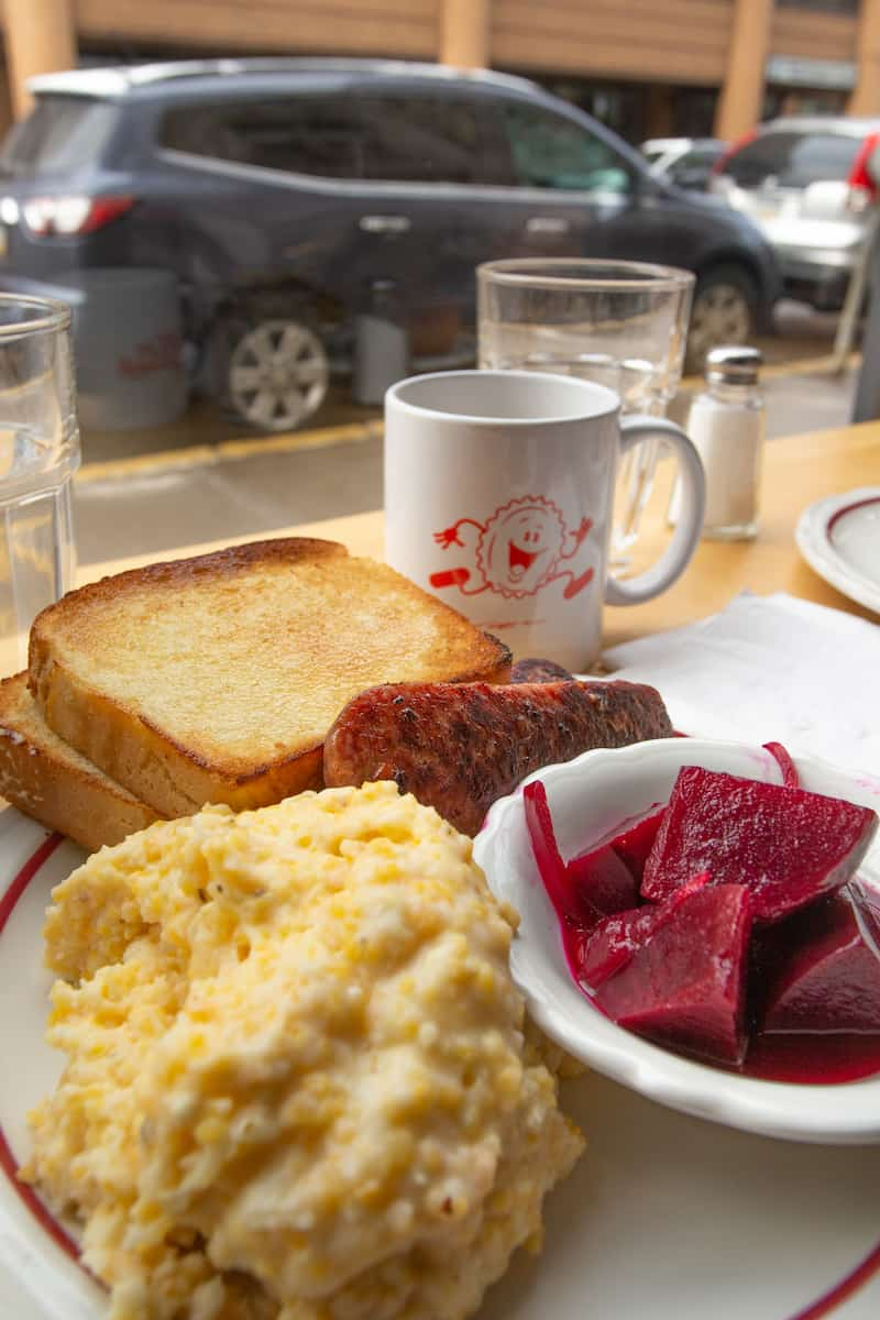 Grits with kielbasa and pickled beets are a savory breakfast at Pittsburgh's Pie for Breakfast.