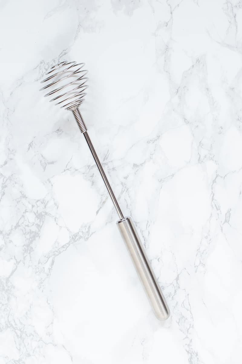 Learn about the different types of whisks and when to use a coil whisk or spring whisk when cooking or baking. #whisks #kitchenutensils