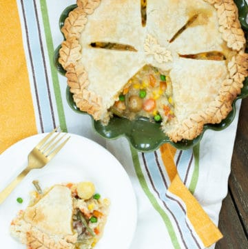 Chicken pot pie made from scratch is top-notch comfort food. Homemade pie crust, broth, and lots of vegetables set this version apart.
