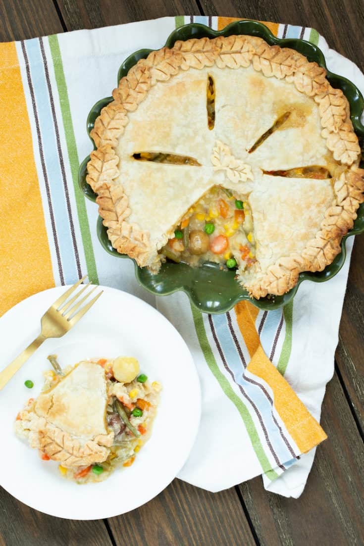 Chicken pot pie made from scratch is top-notch comfort food. Homemade pie crust, broth, and lots of vegetables set this version apart. #chickenpotpie #piecrust