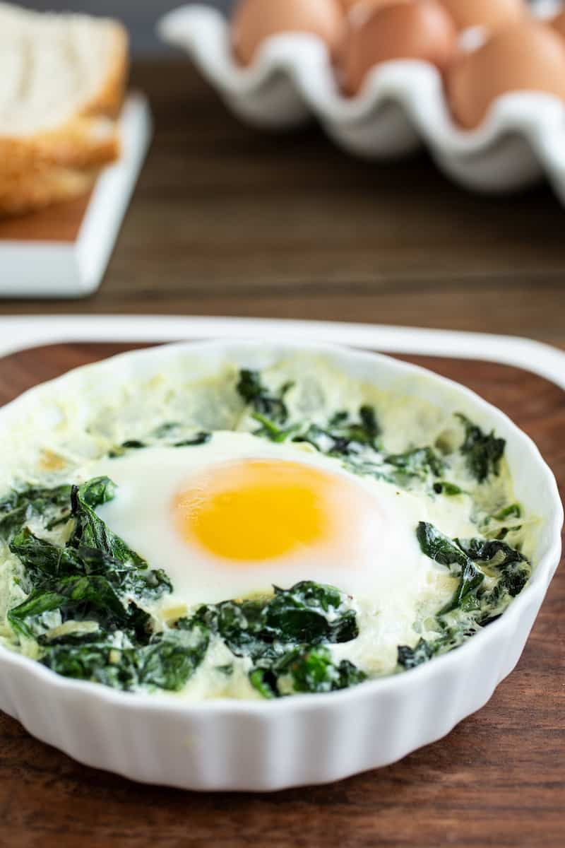 baked eggs in ramekins with spinach and cream