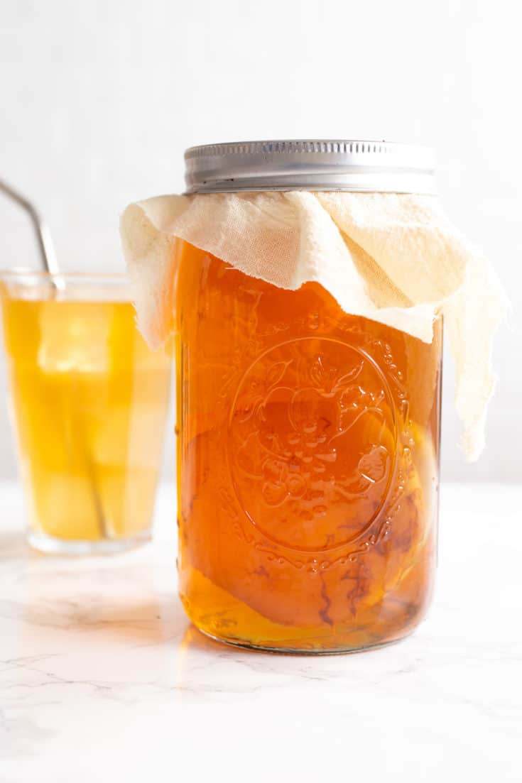 Learn how to make kombucha from scratch, starting with growing your own SCOBY. You can flavor your own kombucha any way you want! #kombucha #scoby #fermentation