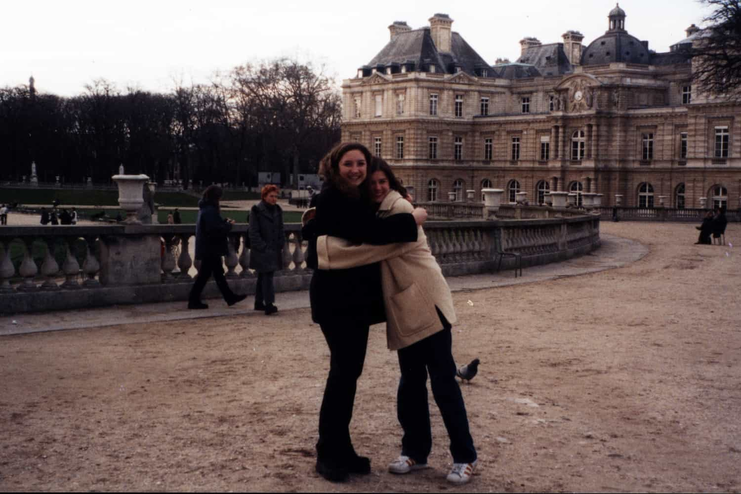 two girls hugging in a park in Paris