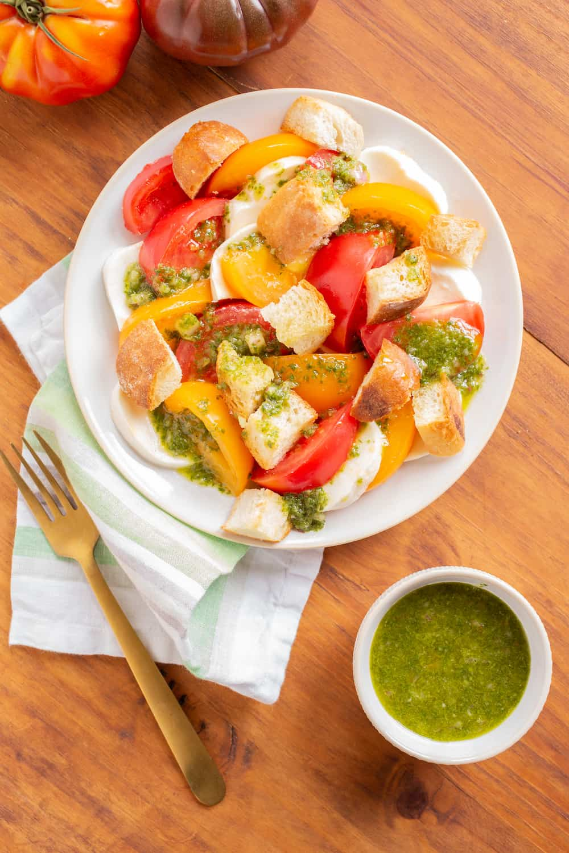 caprese panzanella salad with basil vinaigrette and fresh tomatoes
