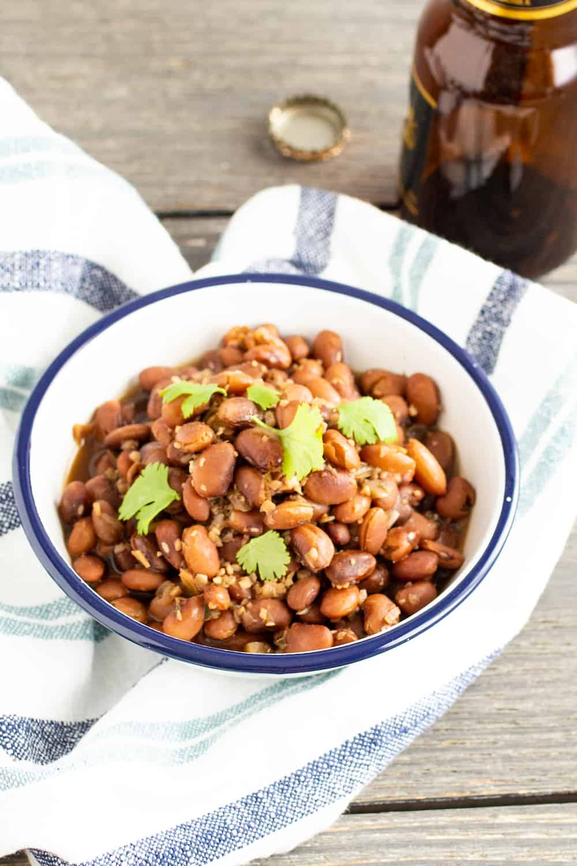bowl of borracho beans with cilantro