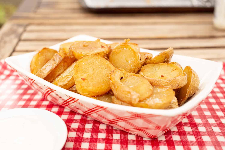 fried buffalo chip potatoes in a basket